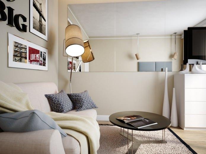 диван с журнальным столиком в интерьере спальни