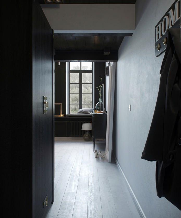 интерьер прихожей в квартире-студии с высокими потолками
