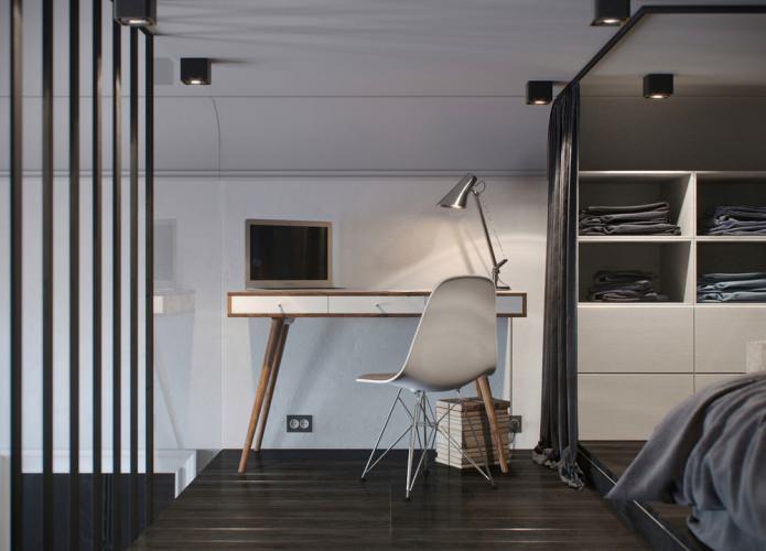 интерьер спальни с рабочим местом в квартире-студии с высокими потолками