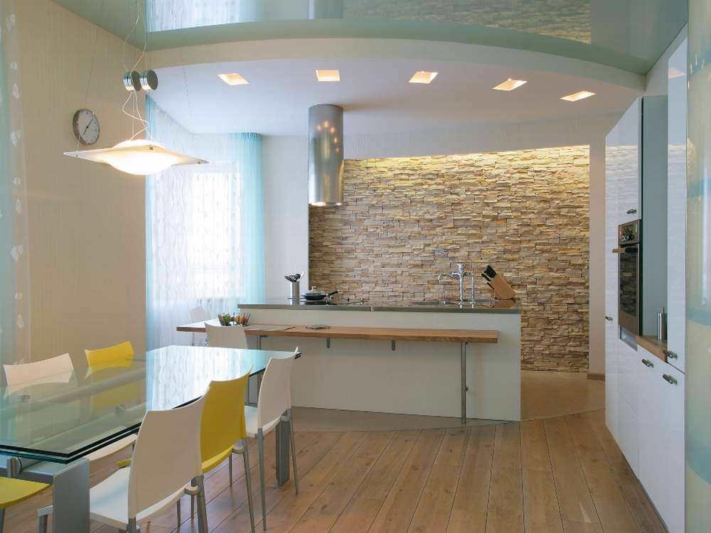 Камень на стене в интерьере кухни