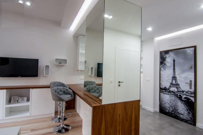 Интерьер совмещенной кухни-гостиной с барной стойкой
