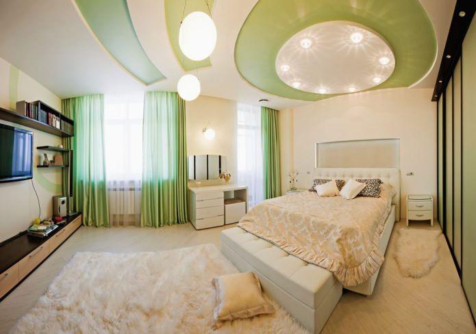 двухуровневый натяжной потолок в спальне белого и зеленого цвета