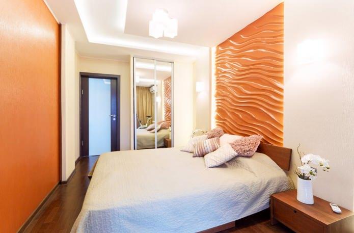 оранжевые 3Д-панели на стене в спальне