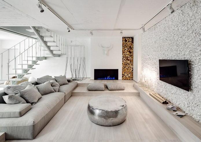 Камень под «гальку» в интерьере гостиной