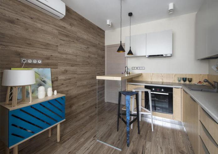 Интерьер кухни с ламинатом на стенах