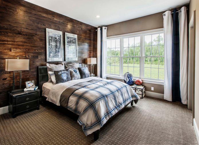 темно-коричневый ламинат на стене в спальне