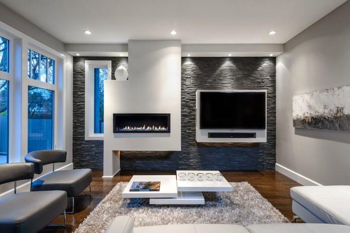 интерьер гостиной с акцентной темной стеной из декоративного сланца