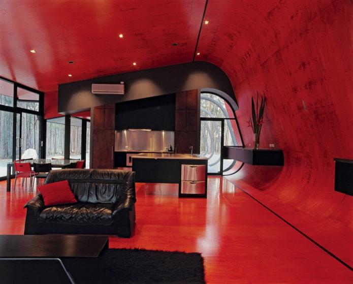 красные стены и потолок с черной мебелью