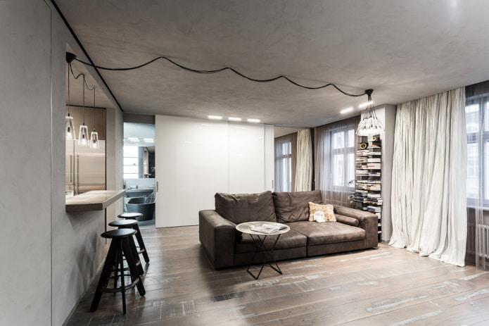 кожаный диван в интерьере в стиле лофт
