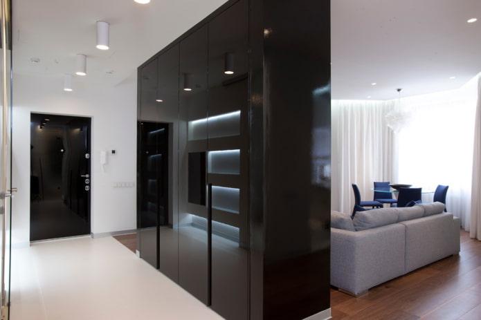 черный шкаф в виде перегородки в интерьере