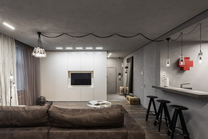 шкаф с телевизором в виде перегородки в интерьере