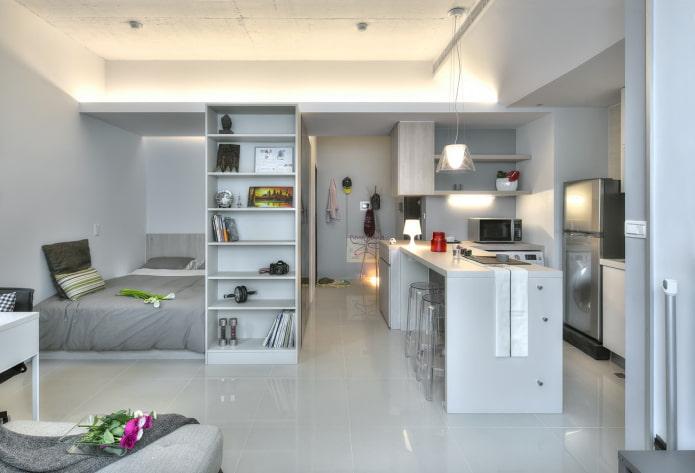 шкаф в виде перегородки в интерьере кухни-спальни