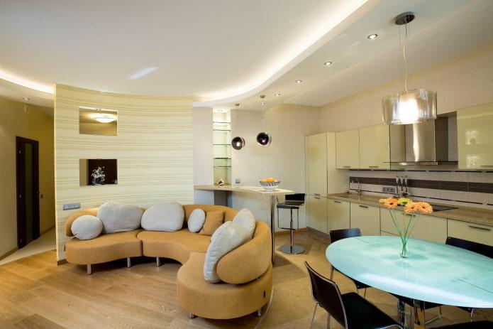 интерьер кухни-студии с зонированием в виде освещения