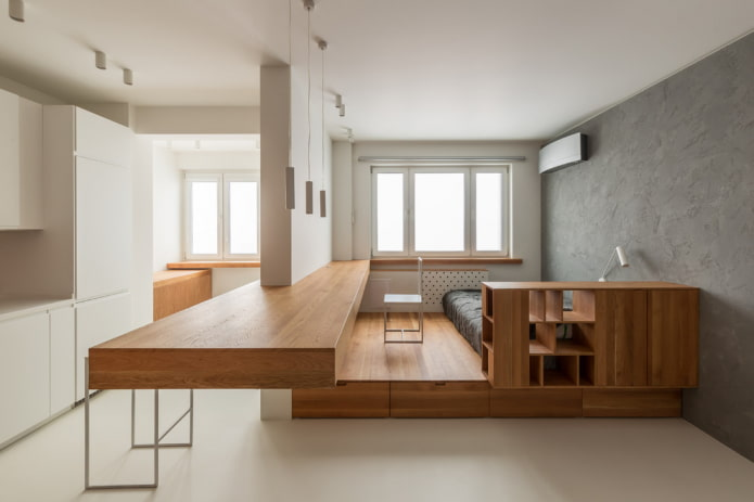 интерьер квартиры-студии с двумя окнами