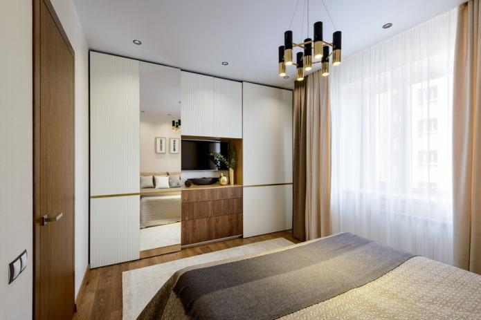 шкаф-купе с телевизором в интерьере спальни
