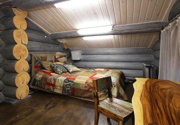 дизайн спальни в интерьере бревенчатого дома