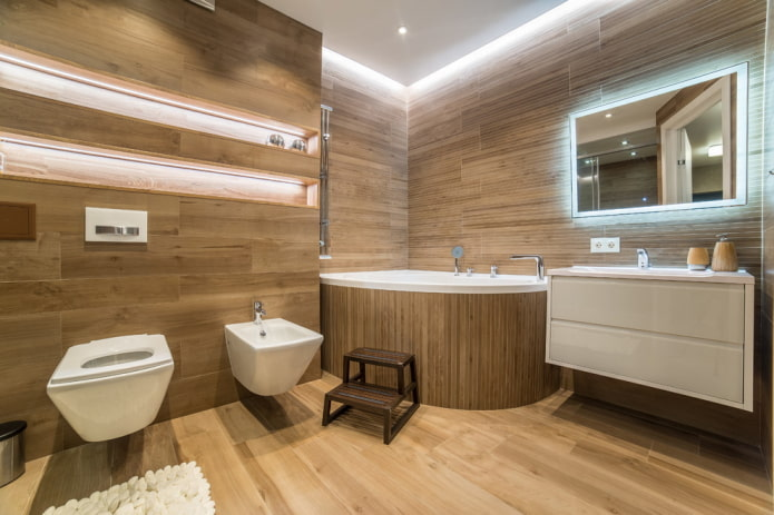 интерьер просторной ванной с угловой акриловой чашей