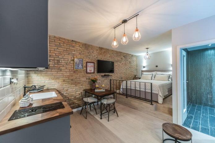 кровать на подиуме в интерьере кухни
