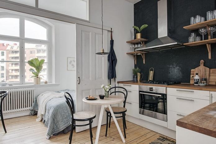 раздвижные двери в интерьере кухни-спальни