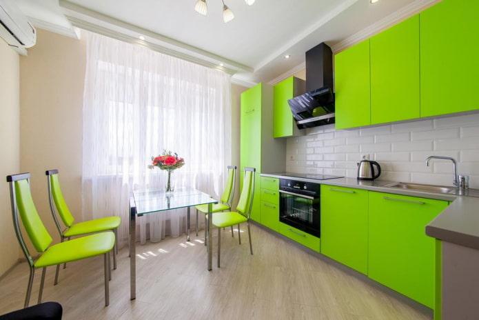 мебель и техника в интерьере кухни в салатовых тонах