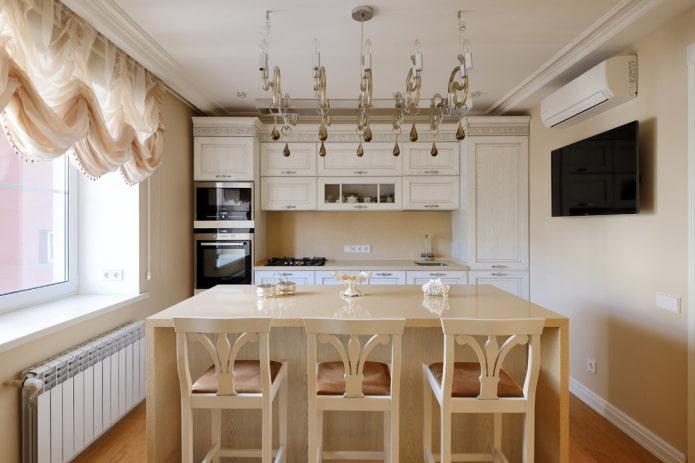 мебель и техника в интерьере кухни в бежевых тонах