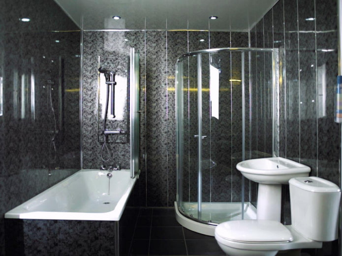 ванная комната отделанная черными пластиковыми панелями