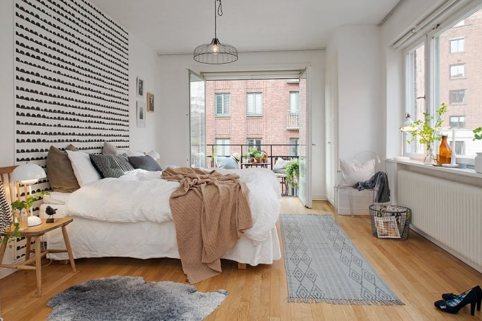 Интерьер спальни с балконом в скандинавском стиле