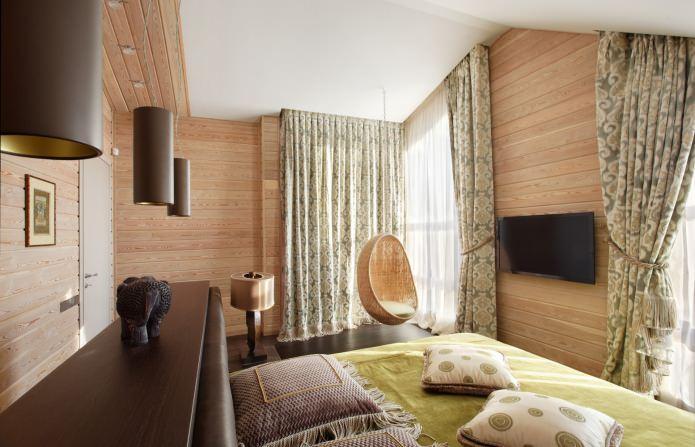 спальня в дизайне деревянного дома из бруса