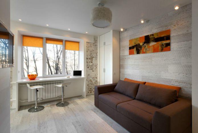 Дизайн квартиры-студии в оранжево-белых тонах